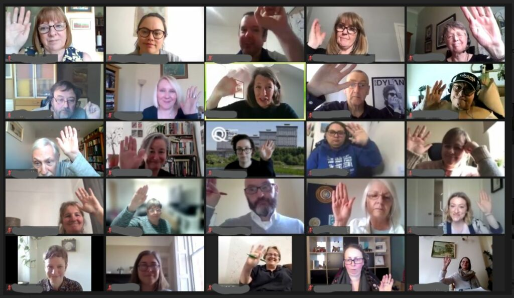 GDA members, disabled people led organisations and public and third sector allies raise their hands on zoom.